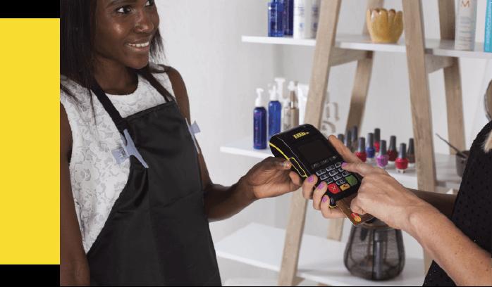 salon owner with ikhokha card machine