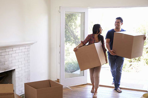 couple moving into house after paying conveyancing fees