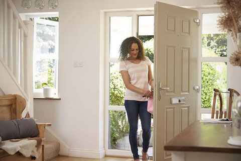 woman moves into new house afforded by work of low cost conveyancers