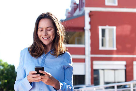 woman viewing online conveyancing site on her phone
