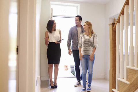 people inspecting a home after the fixed fee conveyancing process