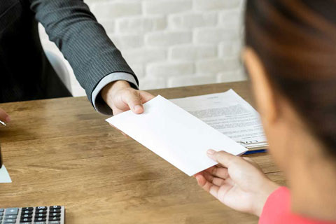 lawyer handing over fixed fee conveyancing form