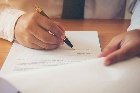 man looking over contract of sale is a conveyancing solicitor