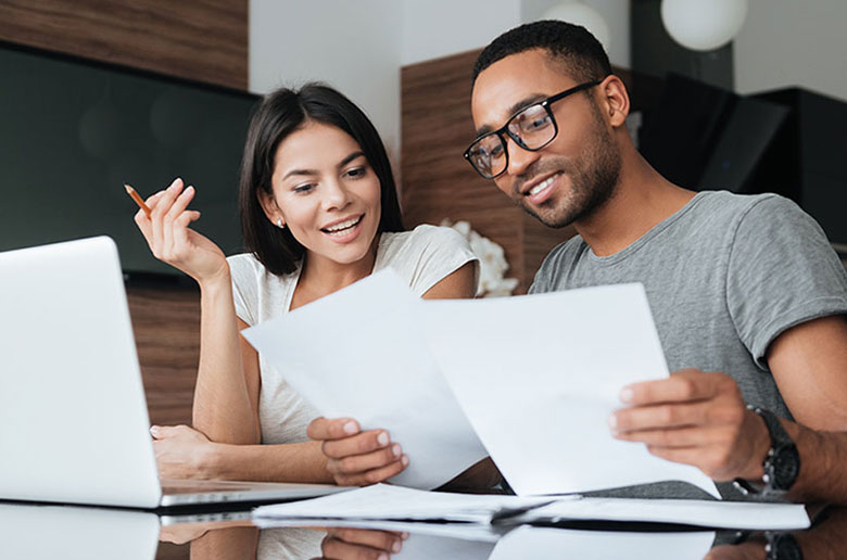 Couple studying important terms in a glossary of conveyancing terms