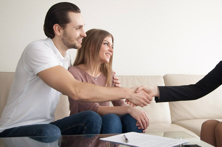 Couple learning how to compare conveyancing costs