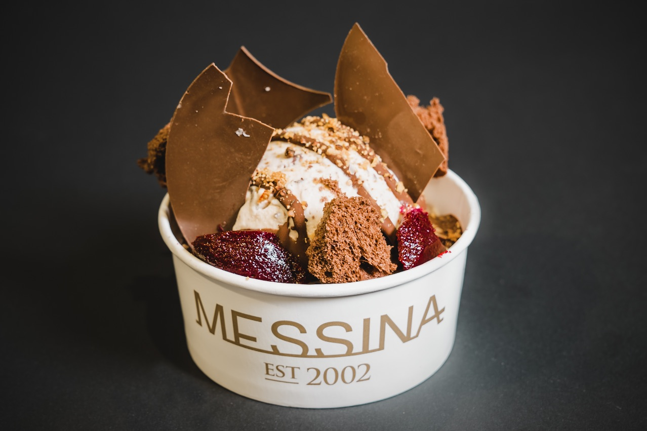 CHOCTIMUS PRIME – Dark chocolate custard, choc chip gelato, salted caramel cream, chocolate mud cake, toasted white chocolate crunch, blackcurrant jelly, dark chocolate sauce and salted dark chocolate shards