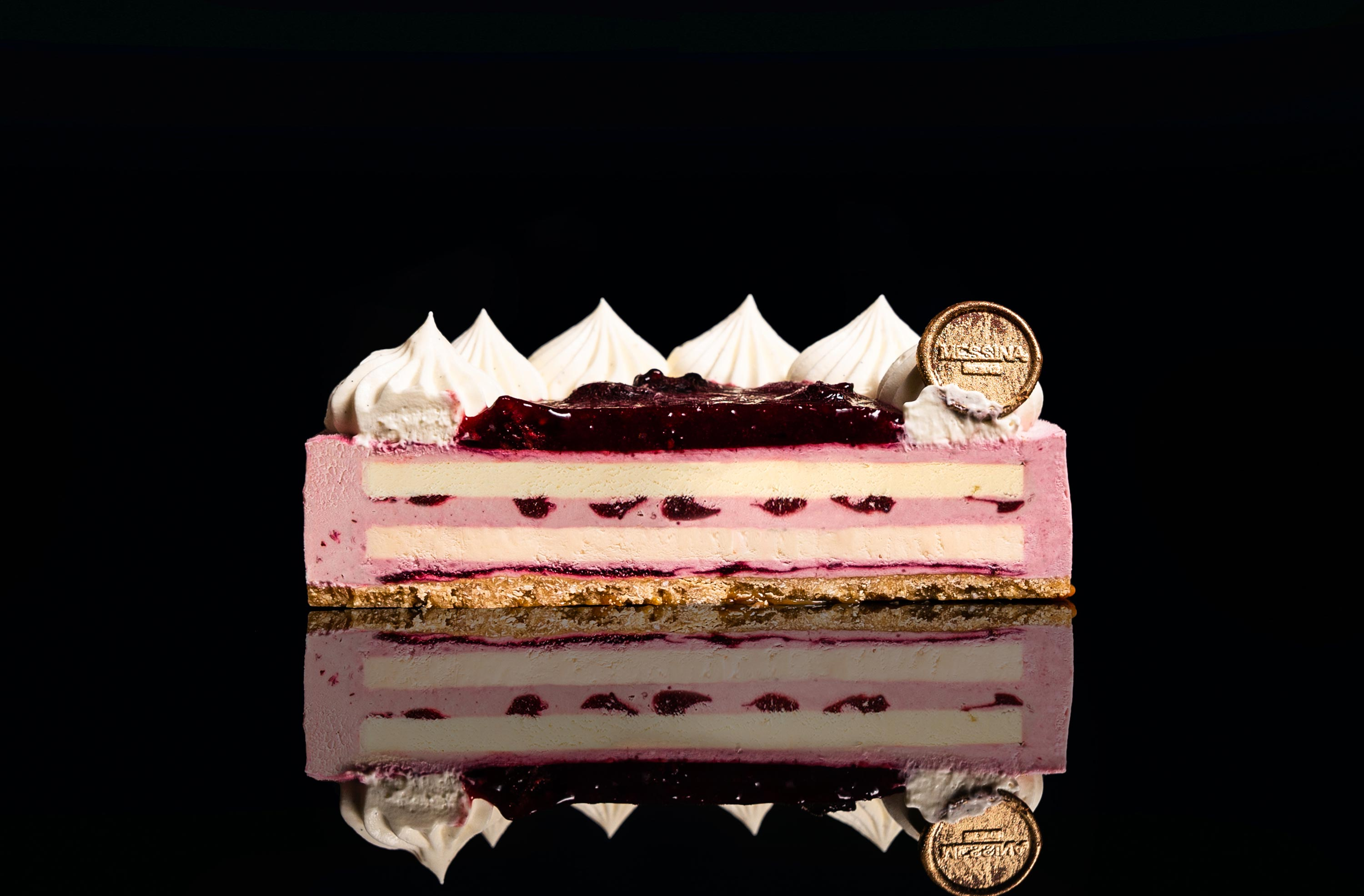 An image of Gelato Messina's Boysenberry Cheesecake cross section.
