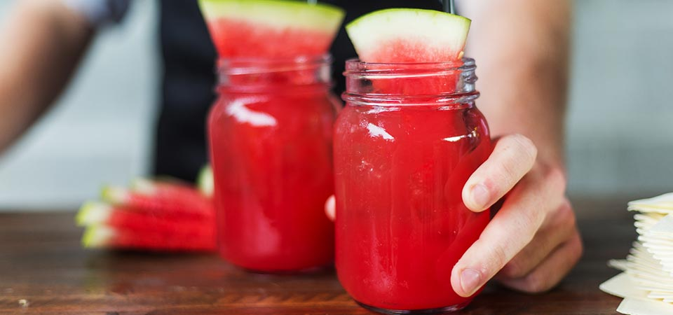 Fresh watermelon mimosa served in mason jars
