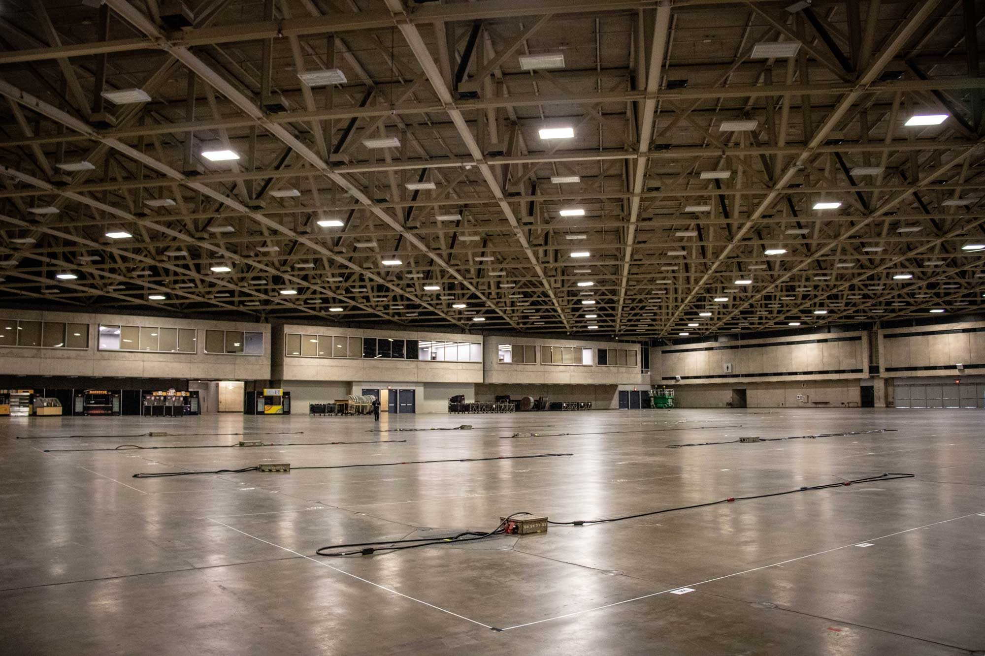 Exhibit hall with electrical utilities placed.