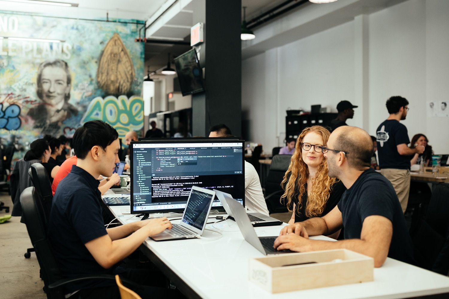 An image of people learning together at the Flatiron School