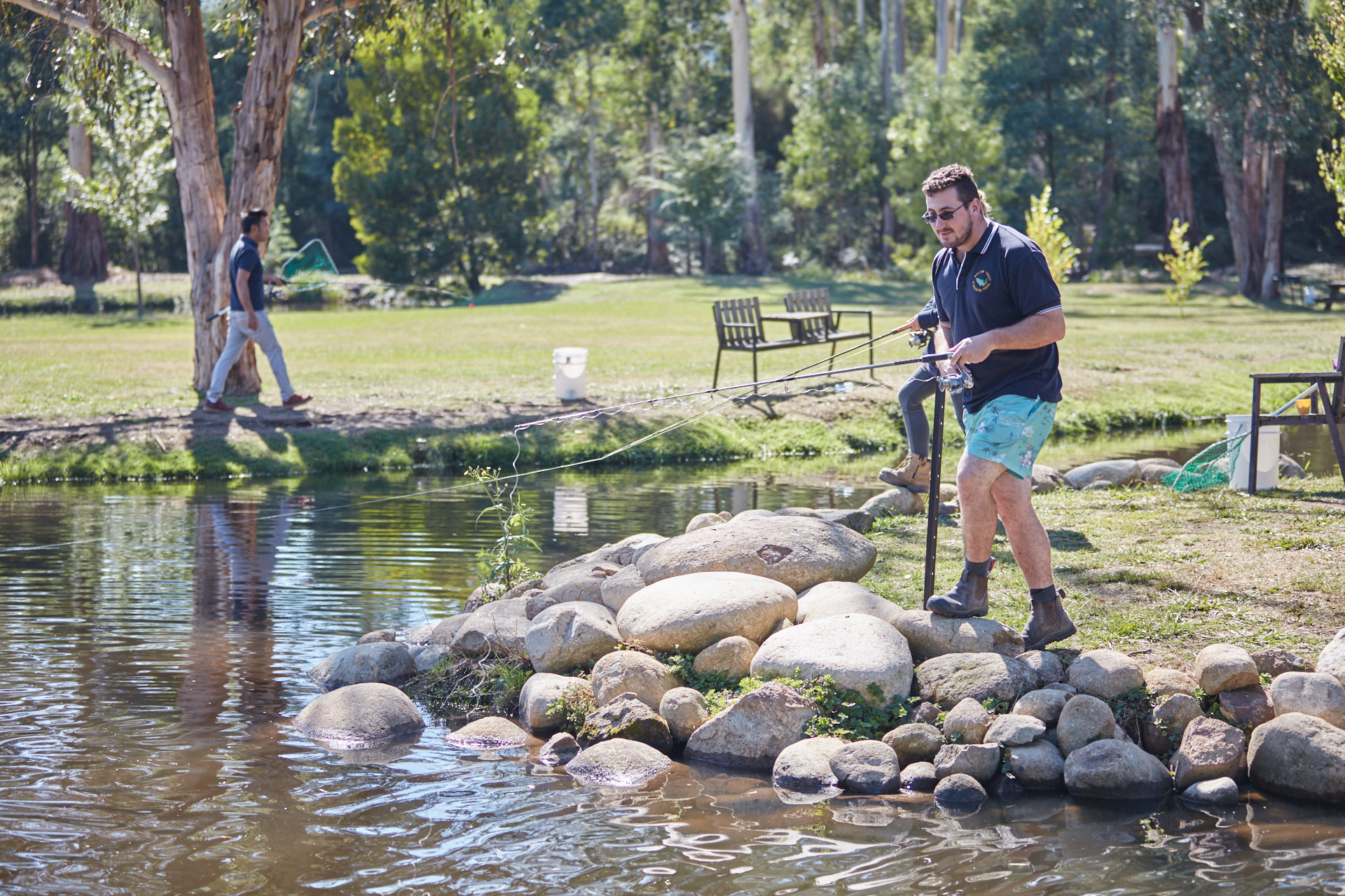 Fishing for trout or salmon in the Victorian bush.