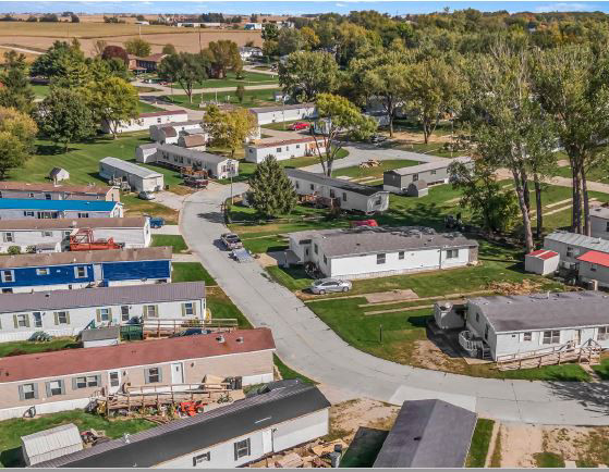 Aerial photograph of a mobile home park community showing several mobile homes situated around a curved road