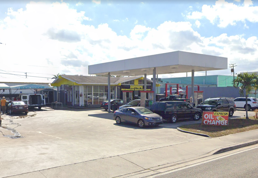 Auto service station with several cars parked across the parking lot.