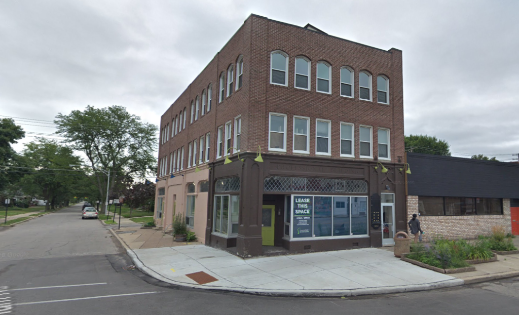 Three story brick office and retail building on a street corner