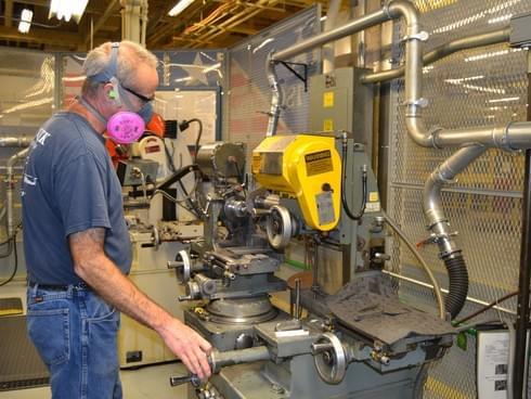 manufacturing worker wearing a respirator