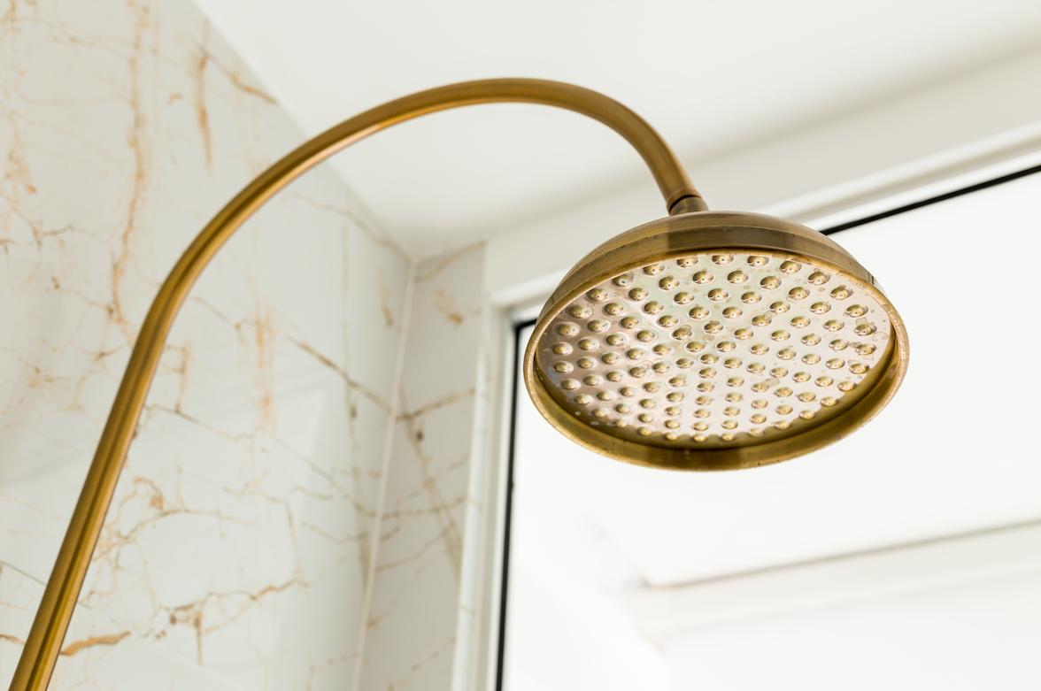 Bronze shower head in a Utah home built by Forum Builders.