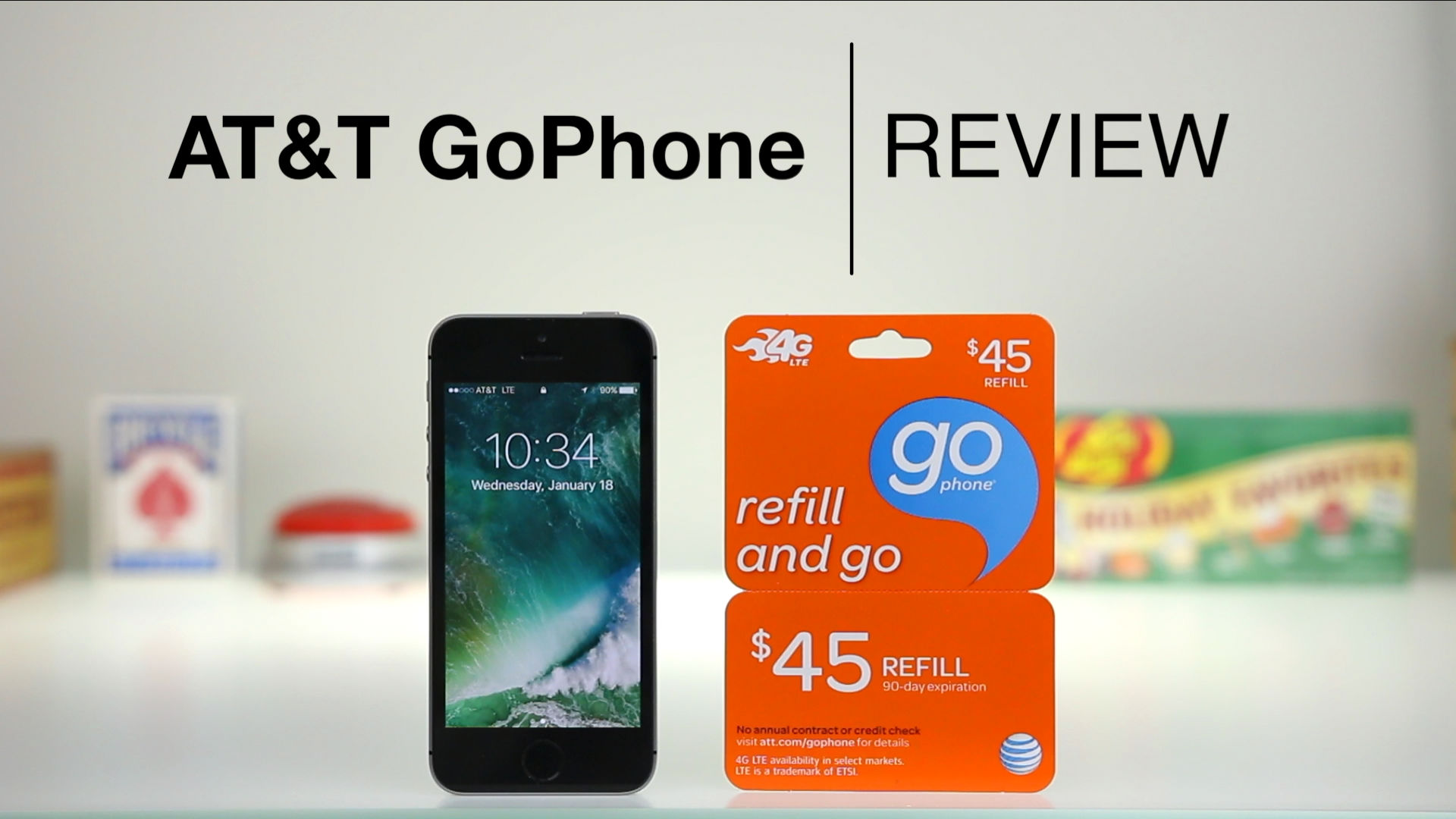 iPhone SE next to AT&T $45 GoPhone starter kit on desk