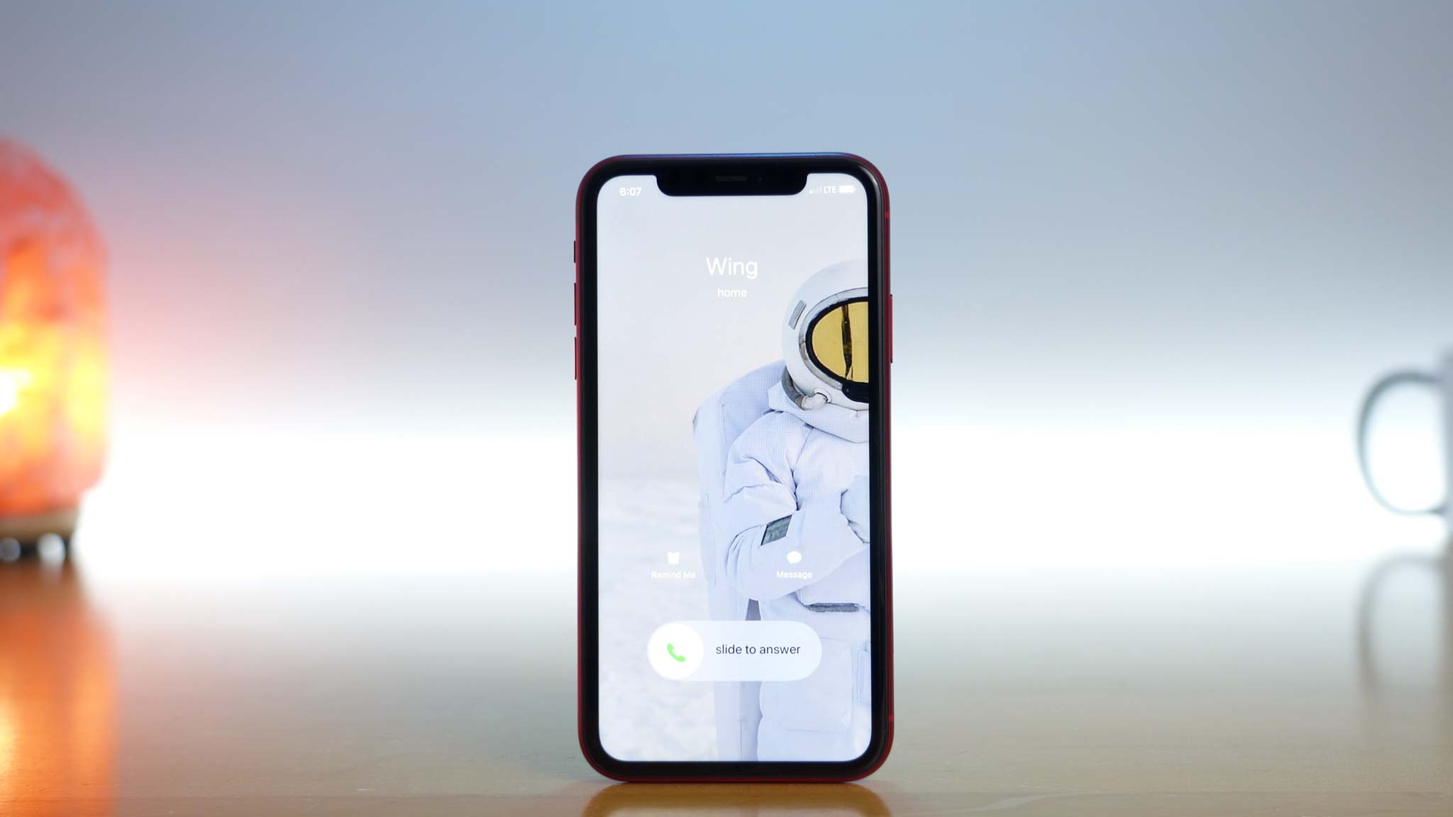 photo of iPhone 11 Pro receiving a call from contact named Wing with an astronaut profile picture