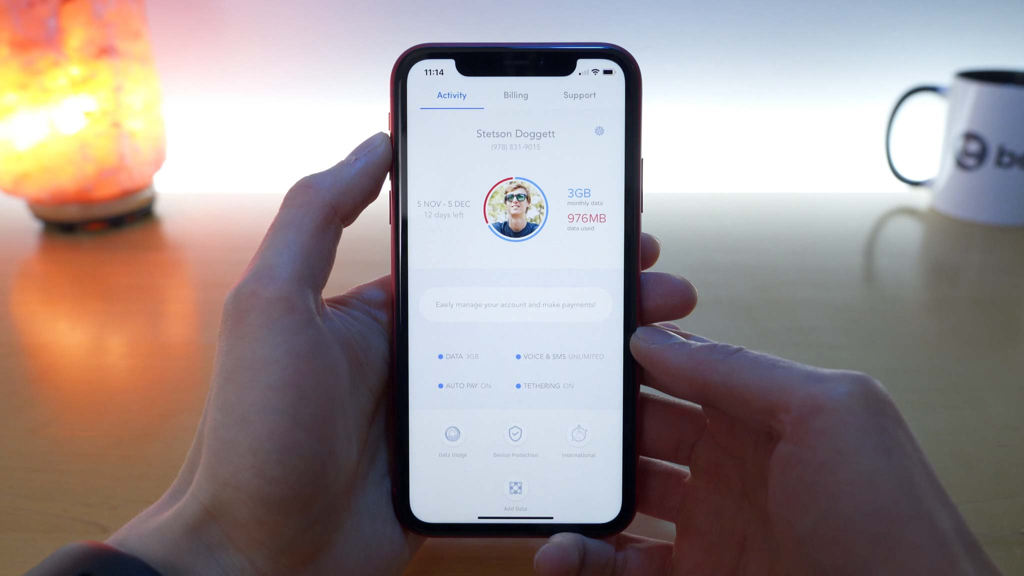 iPhone 11 Pro open to Wing application with overview of account and data usage