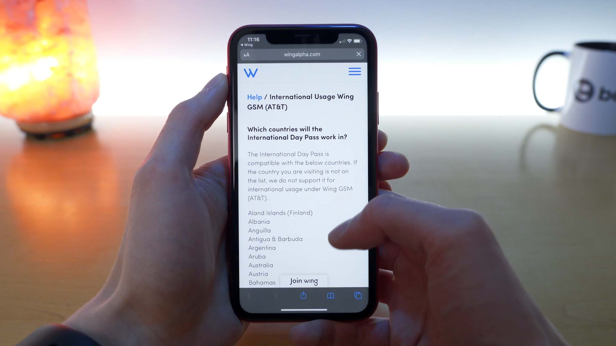 iPhone 11 Pro open to Wing website showing a list of supported international locations