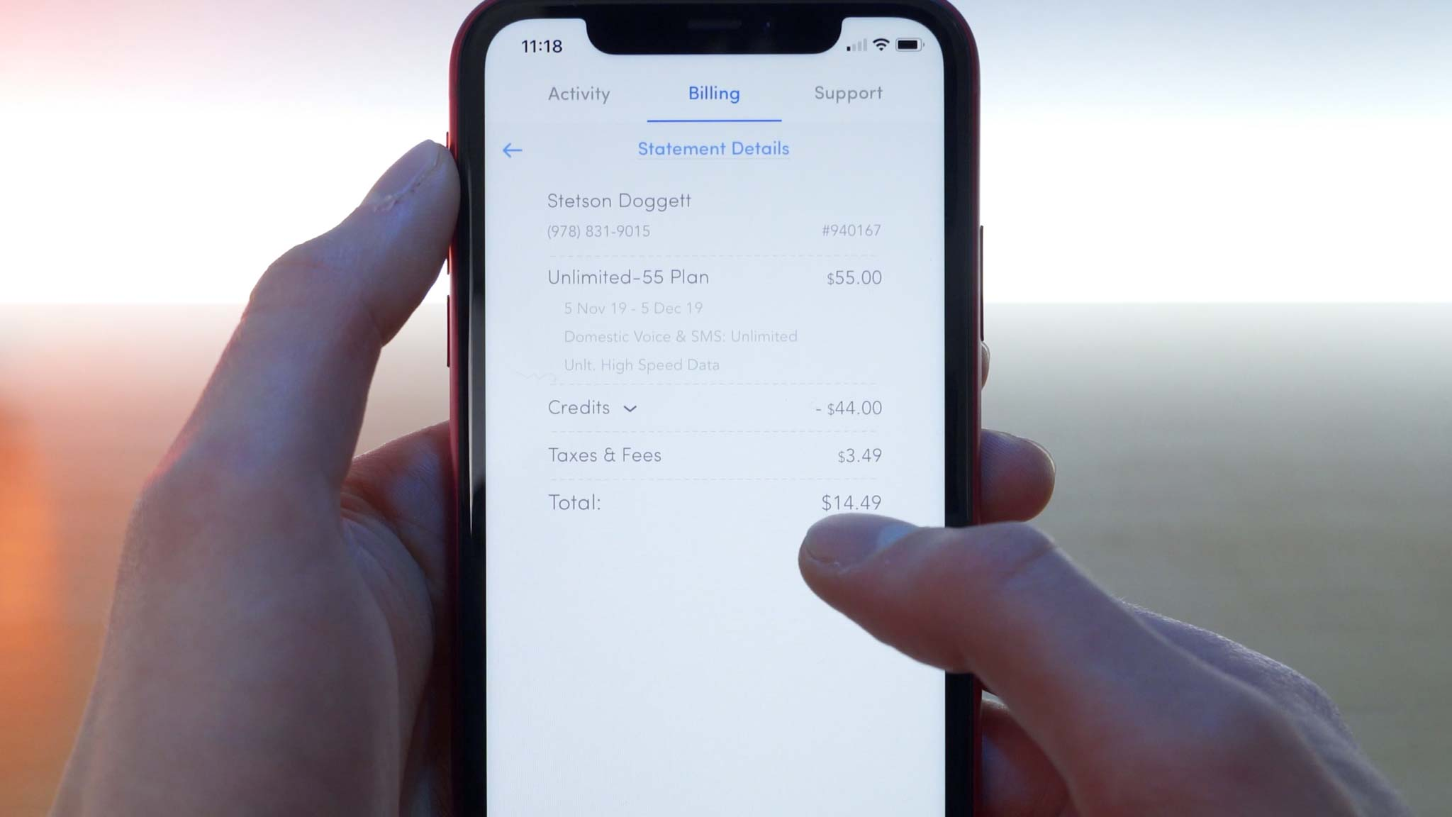 iPhone 11 Pro open to Wing application showing $44 credit received and second month bill was $14.49