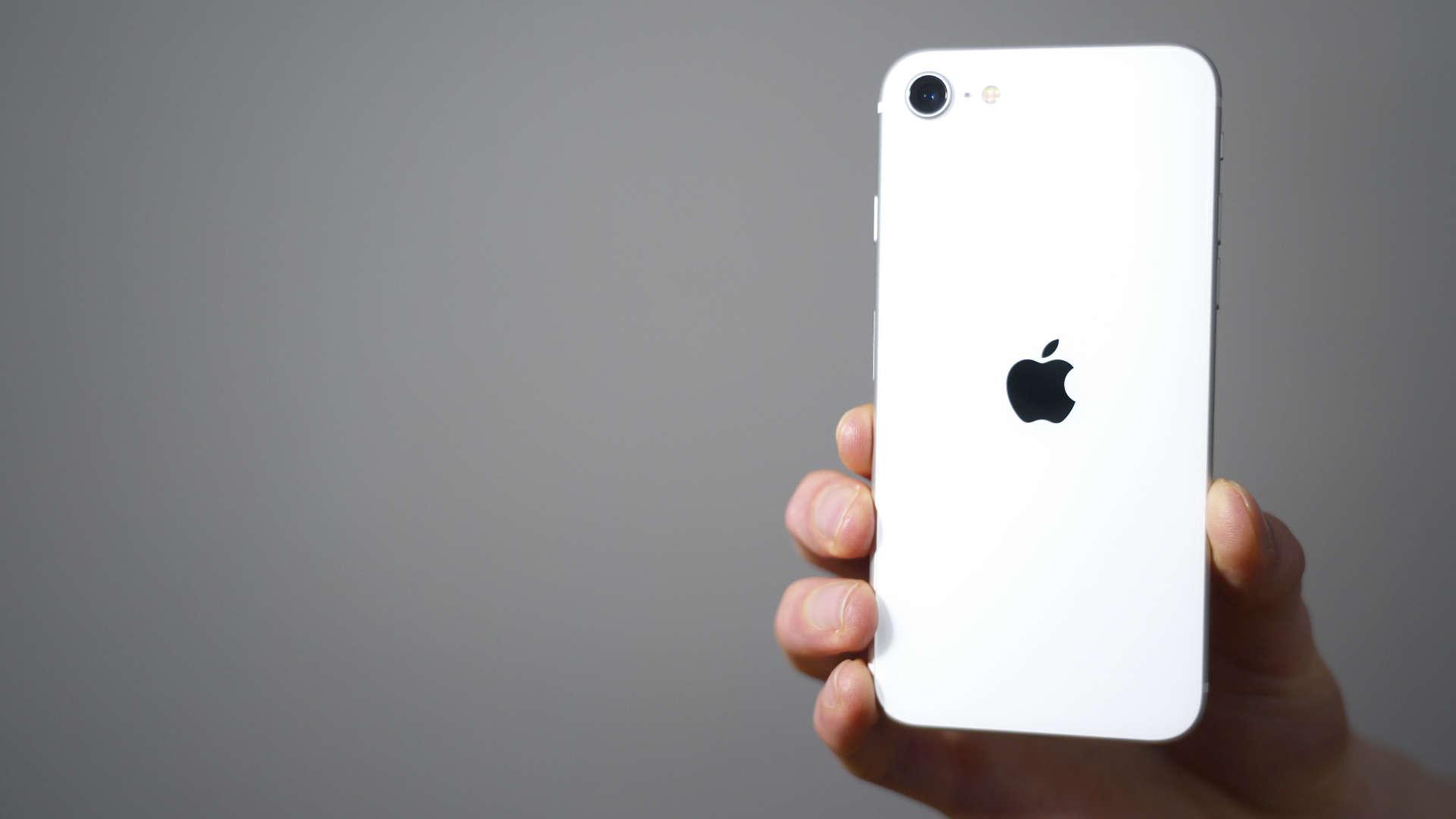 hand holding iPhone SE
