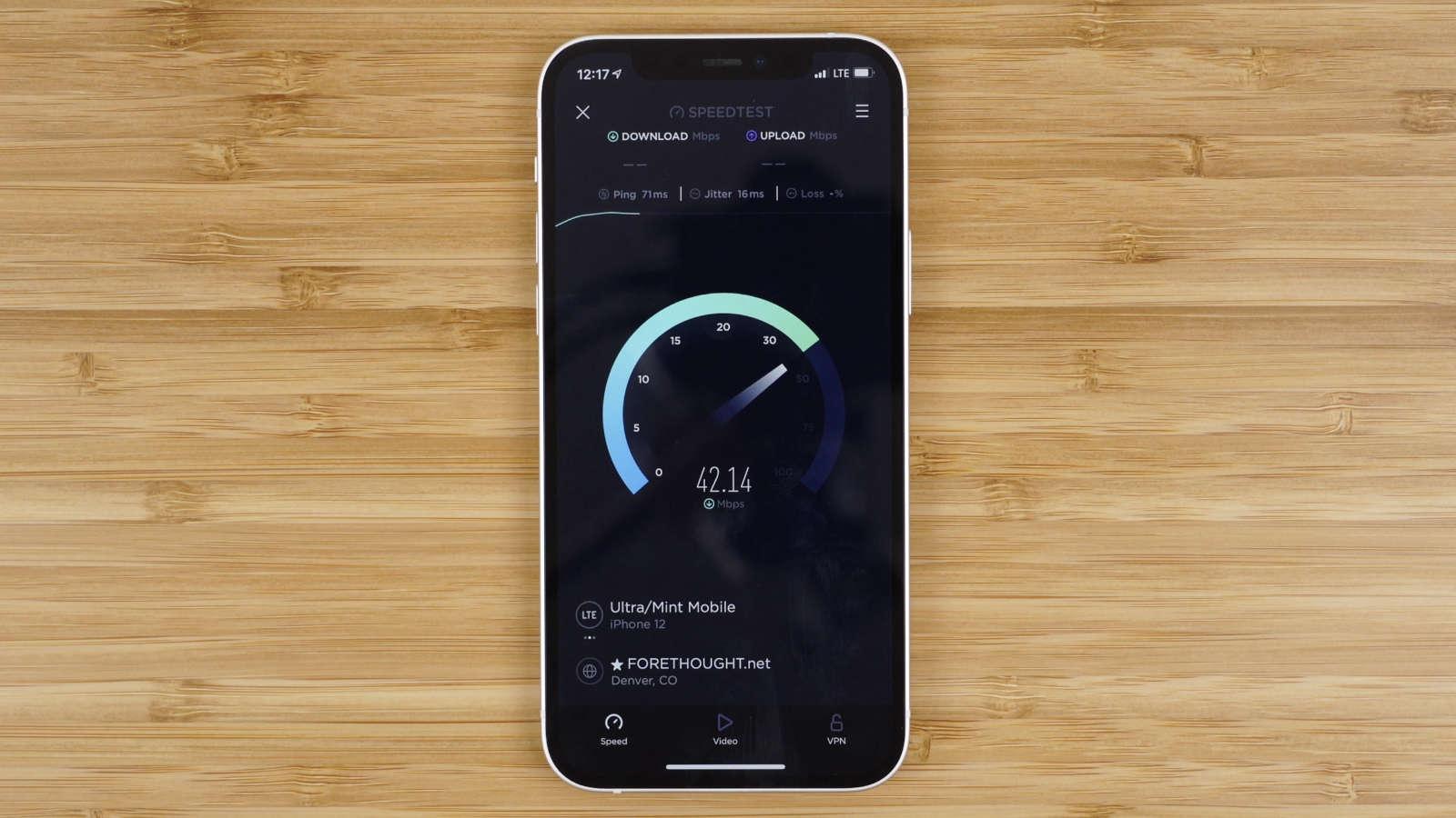 iPhone running cellular data speed test using Ookla's speedtest application