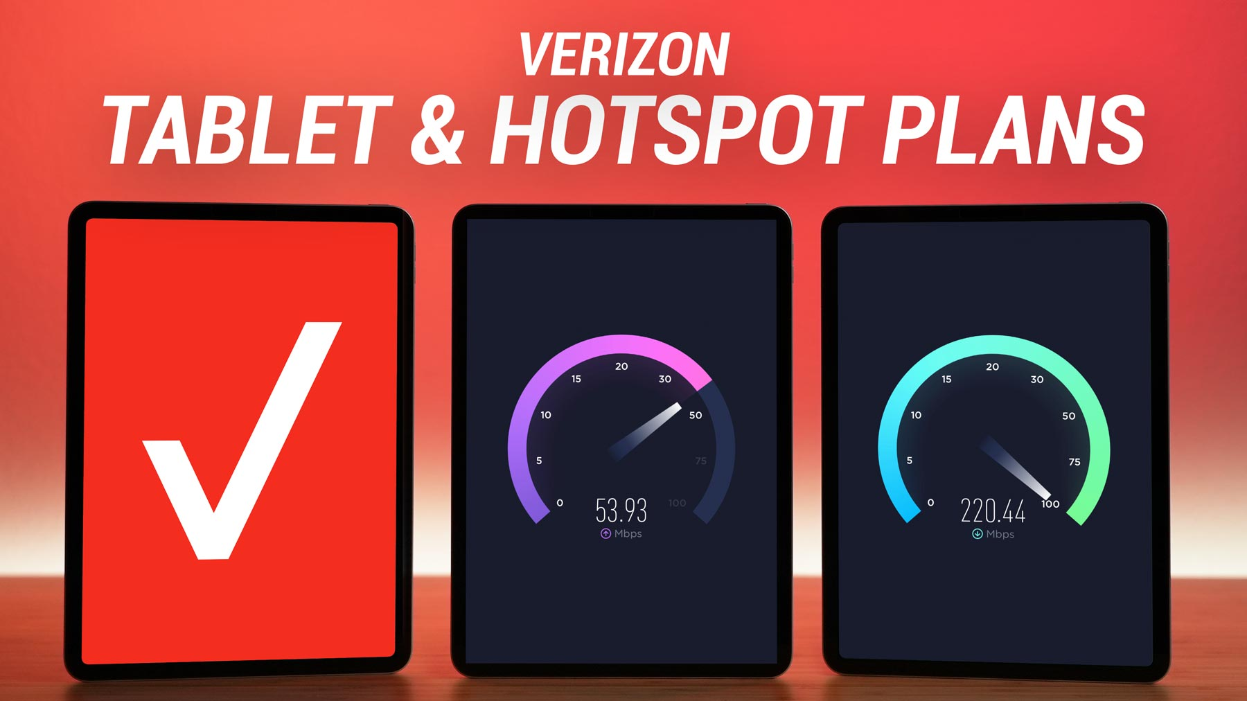 three iPad Pros standing vertically on a table displaying a Verizon logo, download speed test, and an upload speed test