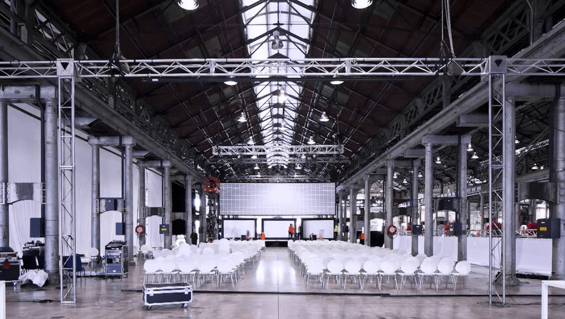 large event venue with white chairs