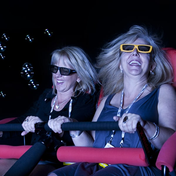 women similing on 4D Motion Simulator