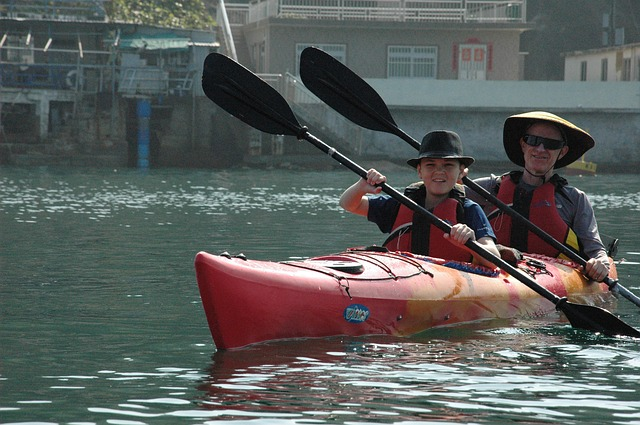 tandem kayakers on river