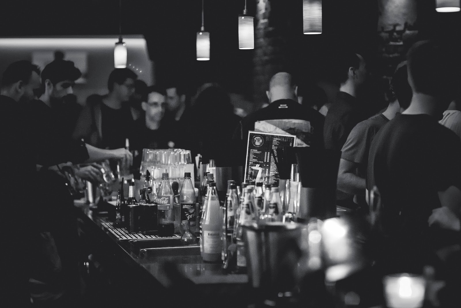 black and white photo looking down a bar