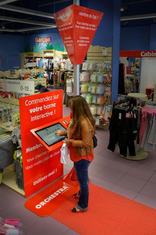 Mother interacting with an Intuiface experience in-store.