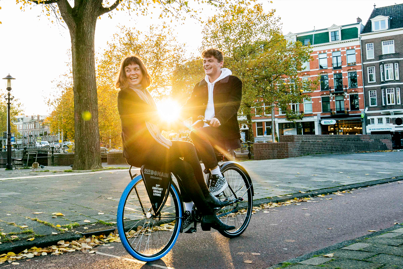 Guy riding a bike in Amsterdam bringing another girl
