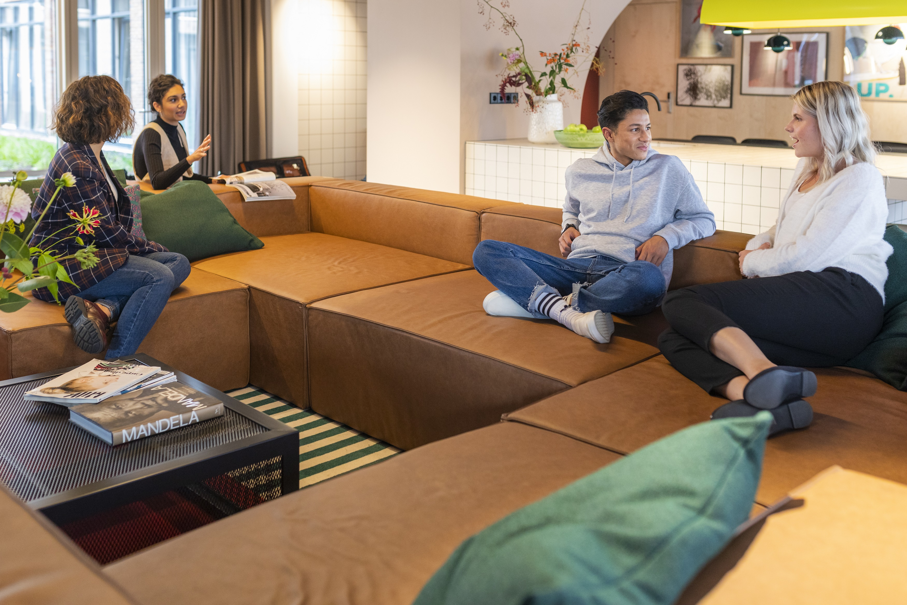 OurDomain Amsterdam Diemen lounge with residents relaxing