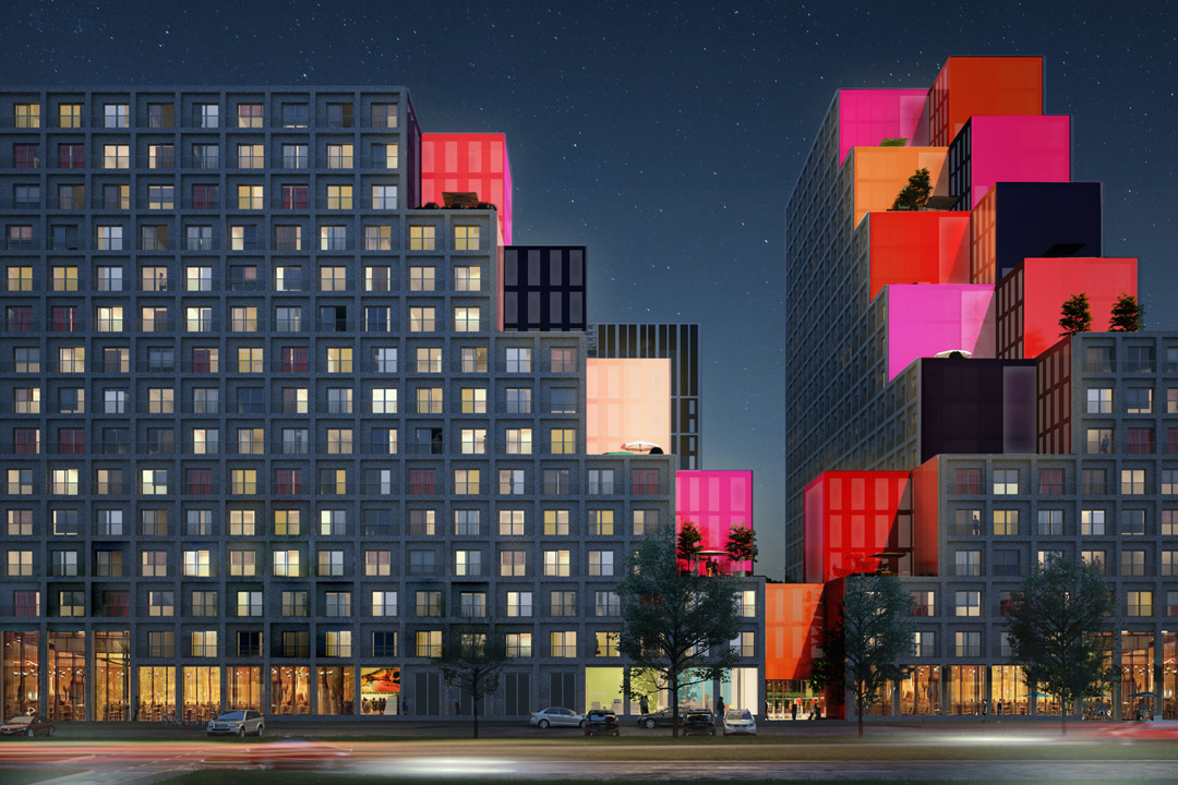 OurDomain Amsterdam South East building façade with coloured blocks at night