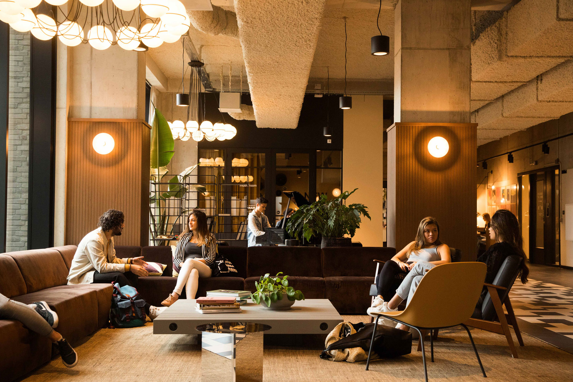 OurDomain Amsterdam South East Facilities: residents chilling in the common area