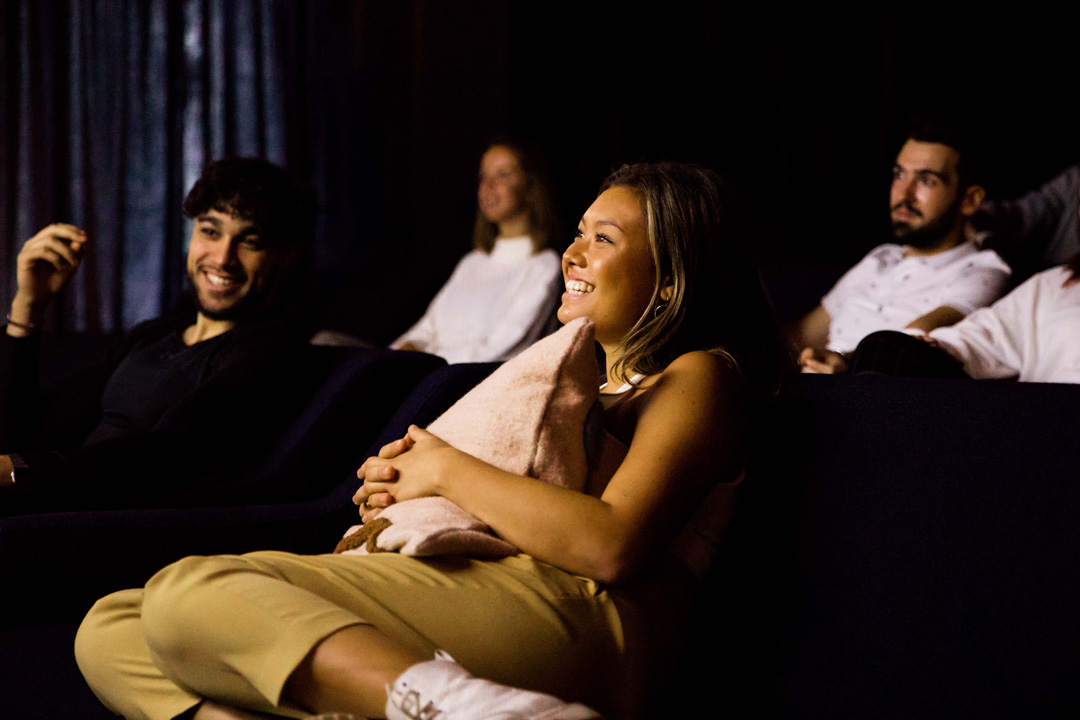 OurDomain Amsterdam South East Homepage: residents laughing in the cinema room