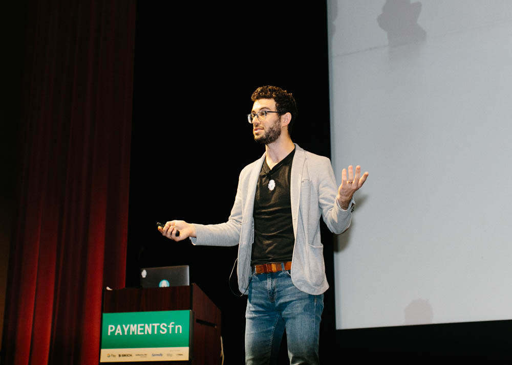 jake kiser presents on stage at payments fn