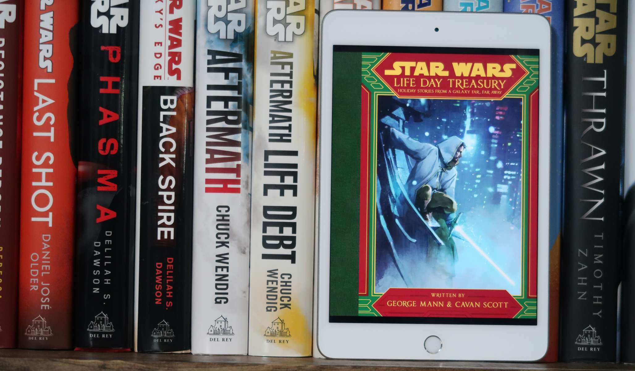 Life Day Treasury cover on an iPad in front of other Star Wars hardcovers