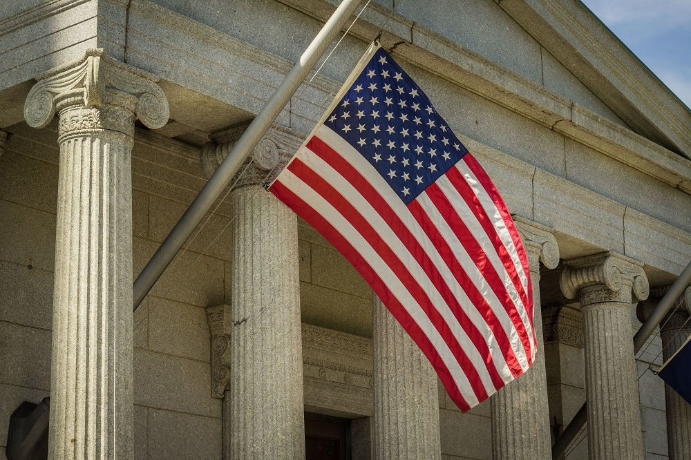 American Flag on flagpole in front of government building