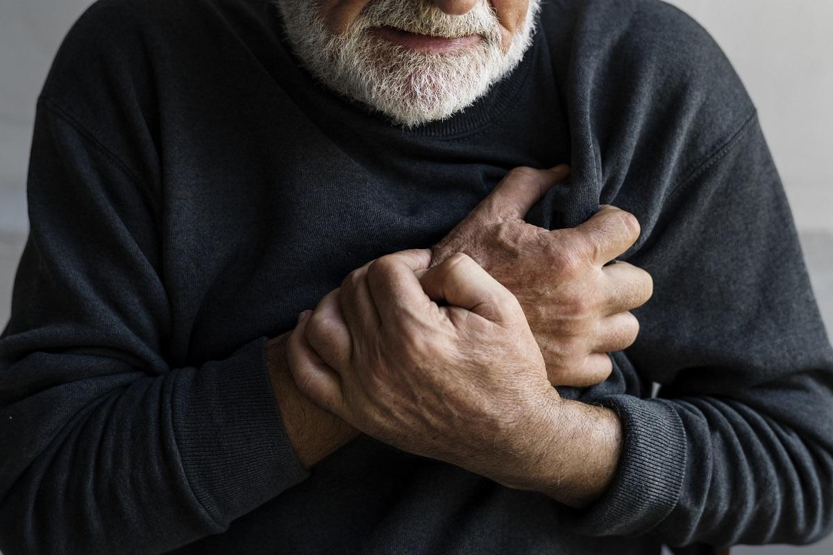 Man grabbing at his heart in pain