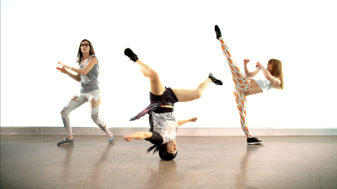 Tv-commercials-red bubble-asher entertainment-bike-bicycle-jump-air-yoga-stretch-kick-dance-dancers