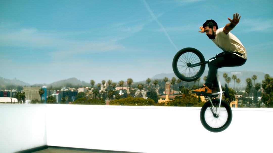 Tv-commercials-red bubble-asher entertainment-bike-bicycle-jump-break-dancing-dancers-bmx-tricks