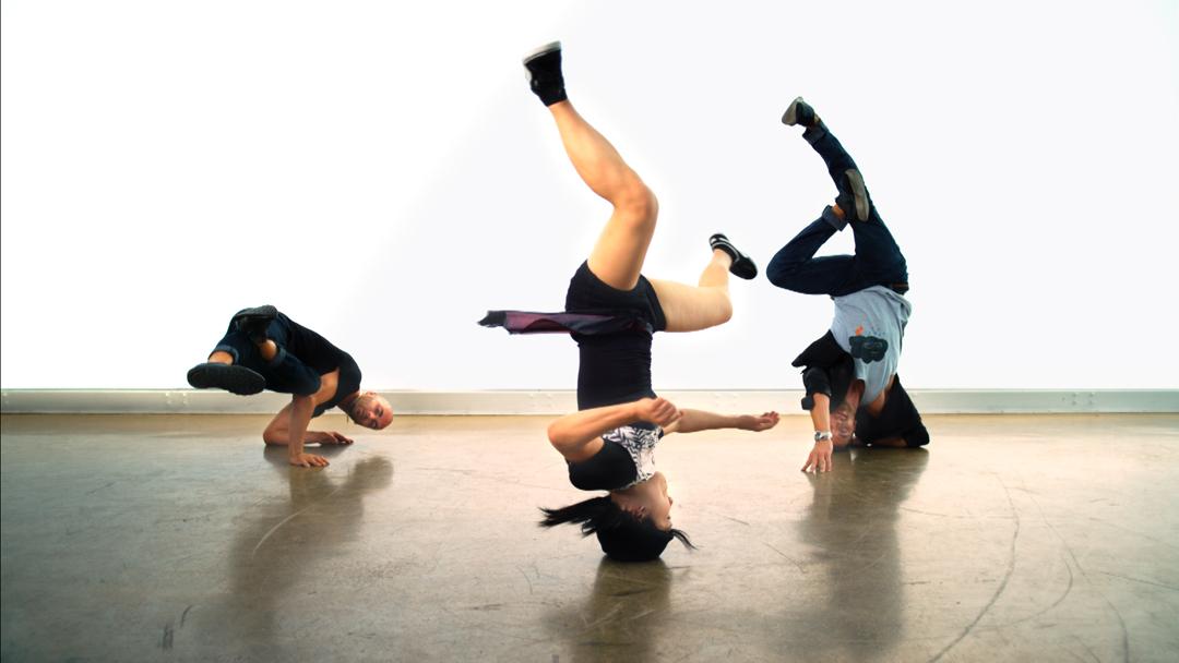 Tv-commercials-red bubble-asher entertainment-bike-bicycle-jump-break-dancing-dancers