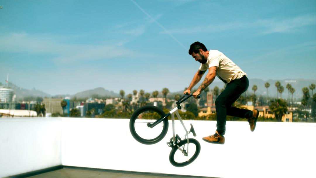Tv-commercials-red bubble-asher entertainment-bike-bicycle-jump-break-dancing-dancers-bmx-tricks-kick-flip