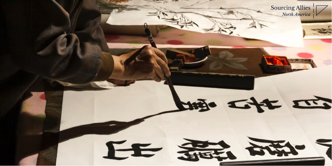 China sourcing agent- Man writing Chinese characters