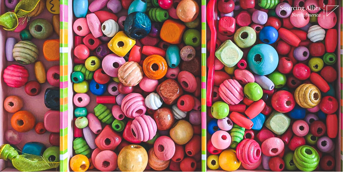 Injection molding- Plastic spoon among set of beads