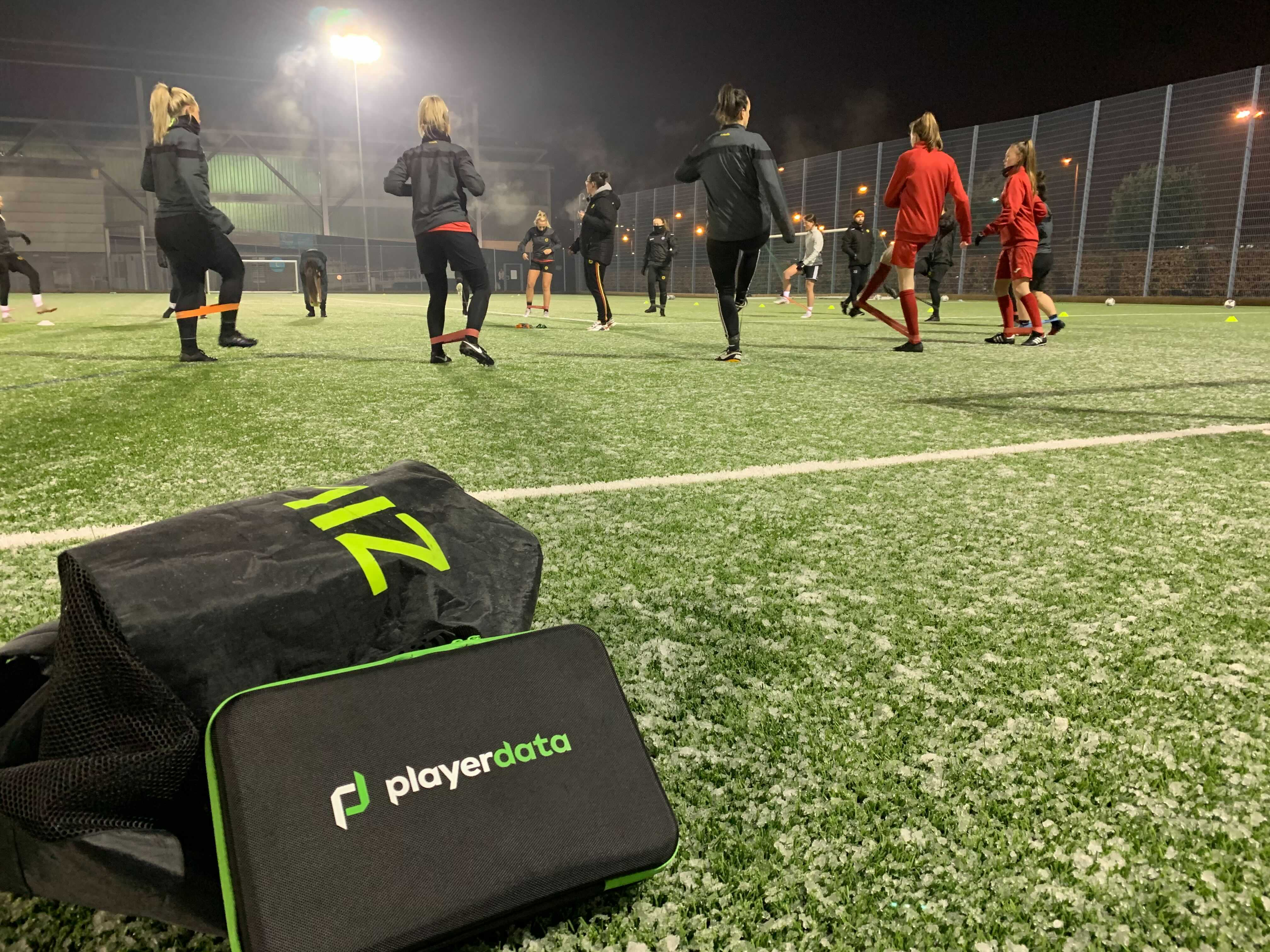 PlayerData product with people playing football behind