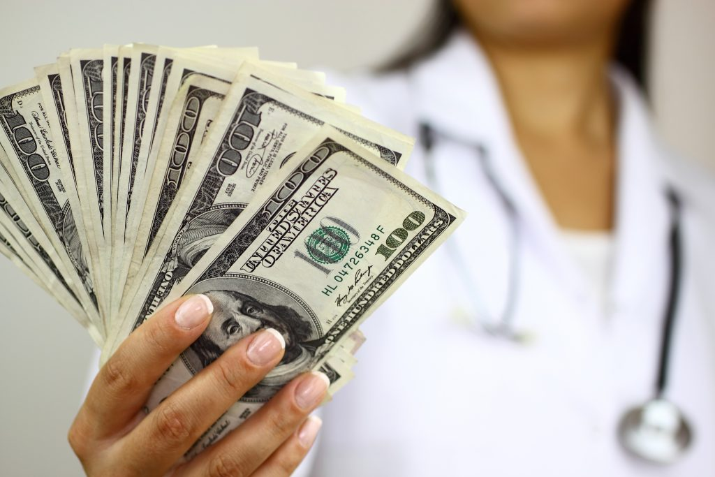 Medical Accounts Receivable Management doctor holding money